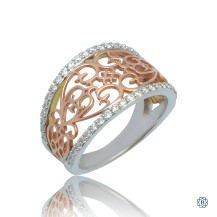 Cathedral Opulence: 10kt rose and white gold 0.35ct diamond ring