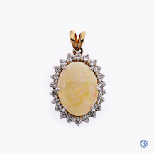 14kt white and yellow gold opal and diamond pendant