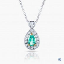 18kt white gold emerald and diamond pendant with chain