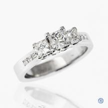 14k white gold 0.52ct Canadian diamond three-stone engagement ring