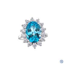 14kt White Gold Blue Topaz And Maple Leaf Diamond Ring
